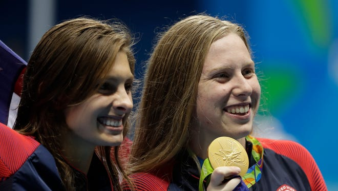 Winner United States' Lilly King, right, and third place United States' Katie Meili show their medals after the women's 100-meter breaststroke during the swimming competitions at the 2016 Summer Olympics, Tuesday, Aug. 9, 2016, in Rio de Janeiro, Brazil.