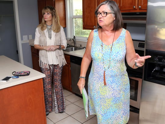 Sharon Kipp, right with Benchmark Realty, shows a Donelson house listed for sale to her client Lisa Powers Thursday September 22, 2016.