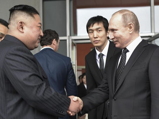 Russian President Vladimir Putin, right, and North Korea's leader Kim Jong Un shake hands after the talks in Vladivostok, Russia, Thursday, April 25, 2019.