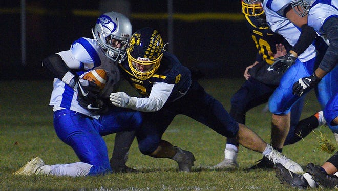 Bridgewater-Emery-Ethan's Carter Dye holds on to the ball making a touchdown in the fourth quarter against Sioux Valley on Friday in Volga.