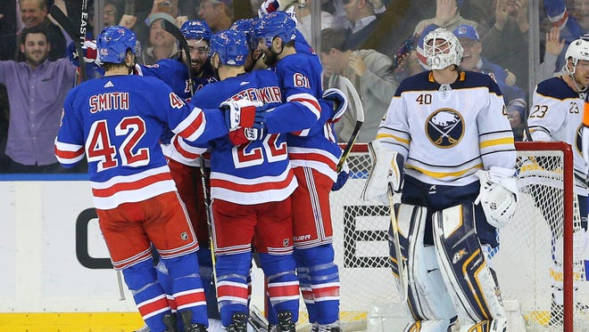 Jan 18, 2018; New York, NY, USA; New York Rangers left wing Pavel Buchnevich (89) celebrates his goal against Buffalo Sabres goalie Robin Lehner (40) with teammates during the third period at Madison Square Garden.