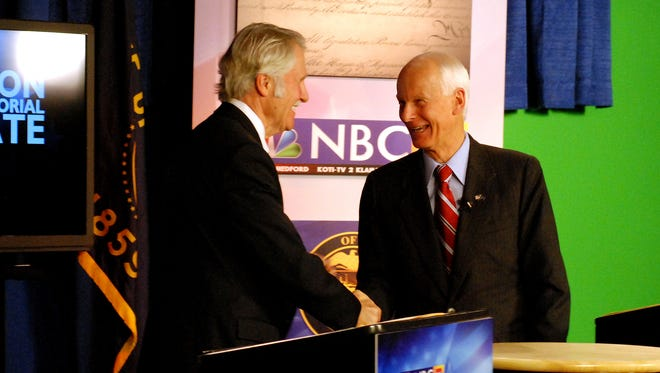 Democratic Gov. John Kitzhaber, left, shakes hands Monday night with Republican challenger state Rep. Dennis Richardson at the conclusion of their sixth and final debate in the studios of KOBI television in Medford, Ore., Monday, Oct. 20, 2014. (AP Photo/Jeff Barnard)