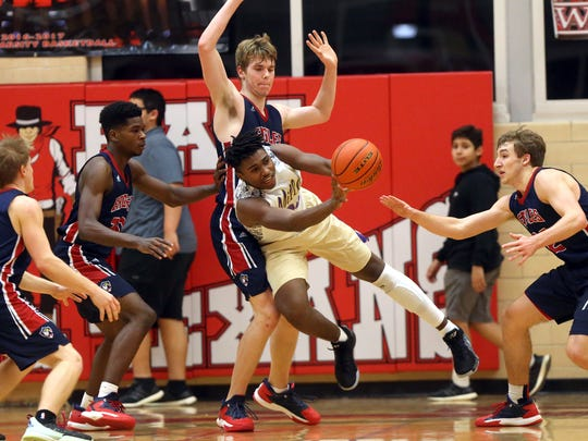 Miller's Justice Watson passes the ball against Veterans Memorial during the District 30-5A championship Thursday, Feb. 16, 2017, at Ray High School in Corpus Christi.