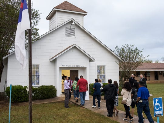 Members walk inside the First Baptist Church of Sutherland