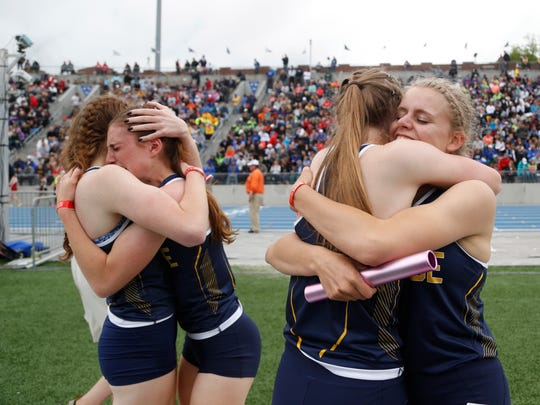 Cascade runners celebrate their win in the 2A girls 4x100 meter relay Saturday, May 20, 2017, at the state track and field championships at Drake Stadium in Des Moines.
