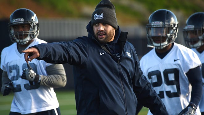 Vai Taua, former Nevada running back and current special teams analyst, helps the team during its first spring camp practice earlier this week.