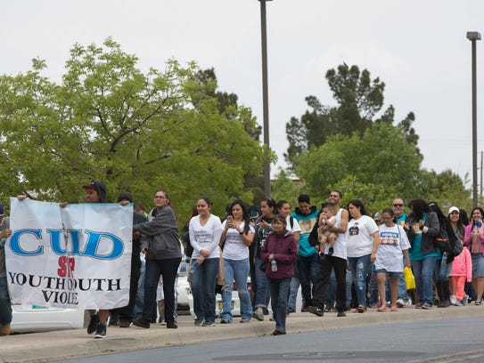 Crime victims families walked together around Young