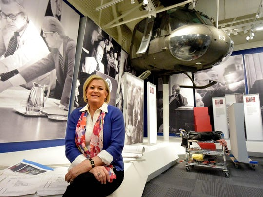 FILE - In a May 16, 2016 file photo, Susan Ford Bales, daughter of late President Gerald R. Ford, talks about the expansion and renovation projects at the Ford Presidential Museum in Grand Rapids, Mich., during a tour of the facility. The museum reopens June 7 after being closed since last fall for renovations. (Dale G. Young/The Detroit News via AP, File)