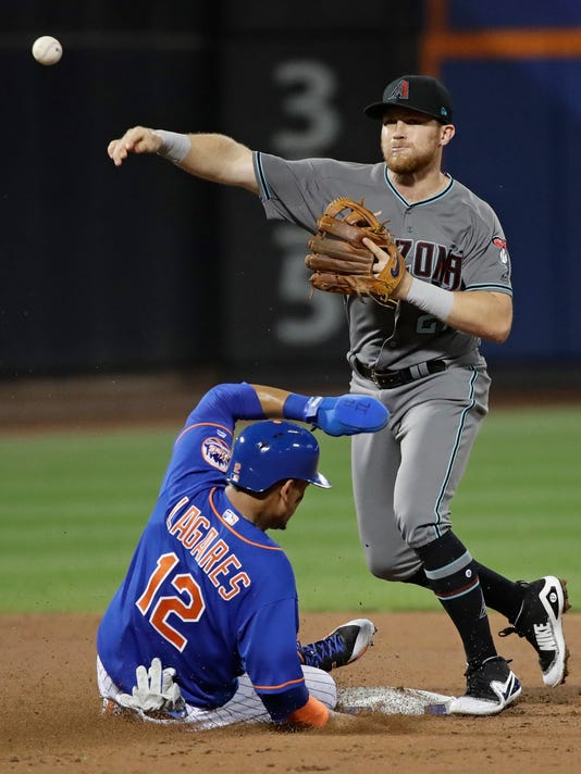 Arizona Diamondbacks second baseman Brandon Drury (27) throws out New York Mets' Asdrubal Cabrera at first base after forcing out Juan Lagares (12) for a double play during the third inning of a baseball game Tuesday, Aug. 22, 2017, in New York. (AP Photo/Frank Franklin II)