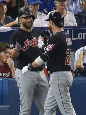 Mike Napoli (left) congratulates Jason Kipnis after Kipnis' solo home run.