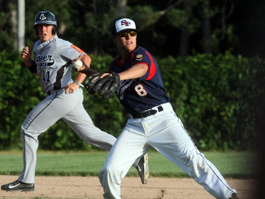 Stevens Point American Legion Post 6 third baseman Brady Erickson throws to first base after fielding a ground ball hit in front of Plover runner Cal Giese Tuesday at Bukolt Park in Stevens Point. Plover posted a 7-0 victory.