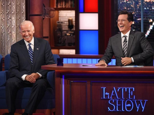 """In this image released by CBS, host Stephen Colbert laughs with Vice President Joe Biden during a taping of """"The Late Show with Stephen Colbert,"""" on Thursday in New York."""