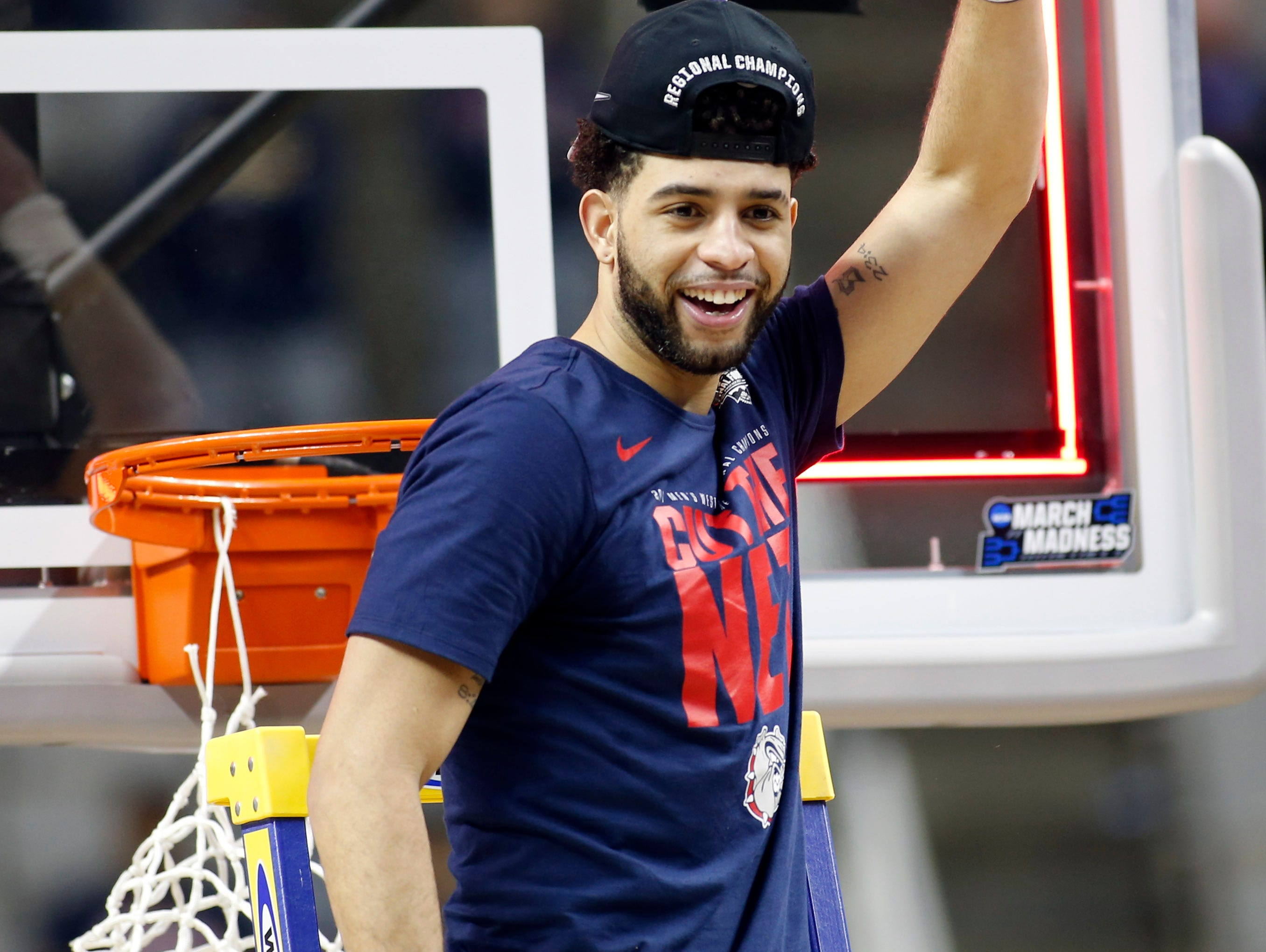 Gonzaga Bulldogs guard Josh Perkins cuts down the net after defeating the Xavier Musketeers in the finals of the West Regional of the 2017 NCAA Tournament at SAP Center.