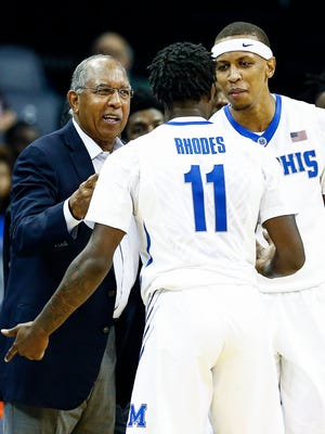 University of Memphis head coach Tubby Smith (left) and forward Jimario Rivers (right) chat with guard Malik Rhodes (middle) during a break in action against LeMoyne-Owen at the FedExForum in Memphis, Tenn., Thursday, November 2, 2017.
