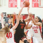 Bullitt East Lady Chargers guard Lindesy Duvall drives to the basket between Butler Bearettes guard-forward Allison Just, left, and Bearettes guard Jaelynn Penn, right. 01 March 2015