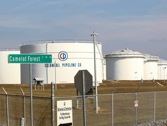 Several Colonial Pipeline Company gas tanks are seen