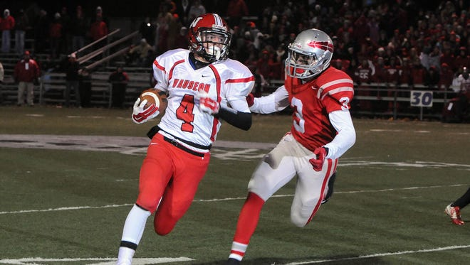 Wauseon's Mason Creager carries the football while Bellevue's Quinton Brimmer gives chase in the 2014 Division IV, Region 12 playoff game. Wauseon defeated Bellevue 34-12. Bellevue will meet Wauseon again Saturday in the first round of the 2015 playoffs.