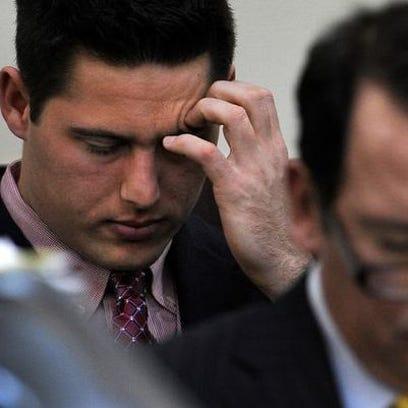 Defendant Brandon Vandenburg listens to testimony from