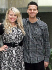 Tawni Nicholson, pictured with her younger brother,