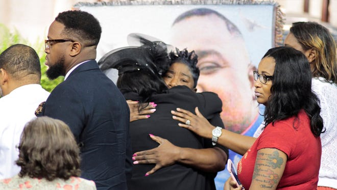 Mourners gather during funeral services for Alton Sterling, who was shot and killed by a police officer last week in Baton Rouge.