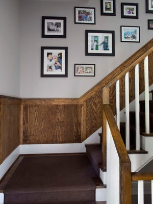 In this photo courtesy of Wood, Naturally and Woodnaturally.com, Dan Faires outfitted the entry of this Atlanta home with pine wainscoting to add a classic architectural touch. The project, featured on wood naturally.com, shows how wainscoting can elevate a lackluster staircase or entry to new heights without undergoing a major remodel.