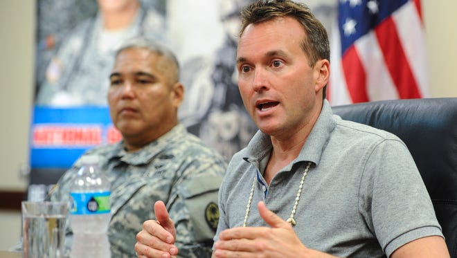 Secretary of the Army Eric Fanning, right, is seated with Brig. Gen. Roderick Leon Guerrero, Adjutant General of the Guam National Guard, as he entertains inquiries from local media representatives during a press conference at Guard's Joint Forces Headquarters in Barrigada on Friday, July 29.