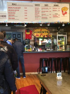 Reggae music sets the mood as you enter Pimento, a fun and mellow bit of Kingston, Jamaica, on Minneapolis' Eat Street. Eat Street is a five-block stretch of Nicollet Avenue just south of downtown with more than 40 wildly diverse restaurants.