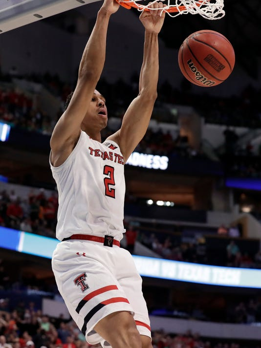 Texas Tech guard Zhaire Smith (2) dunks in the closing seconds of the second half of a second-round game against Florida at the NCAA men's college basketball tournament in Dallas, Saturday, March 17, 2018. (AP Photo/Tony Gutierrez)