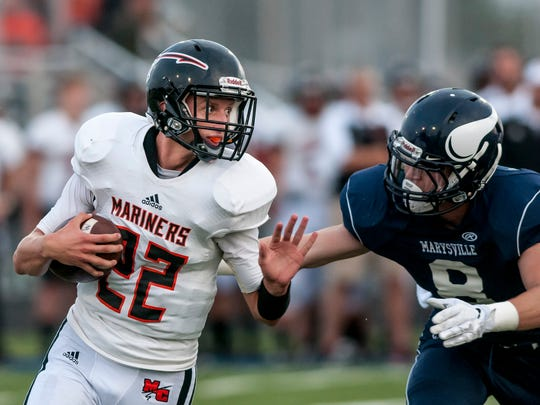 Marine City senior Kohl Sobol runs the ball as Marysville
