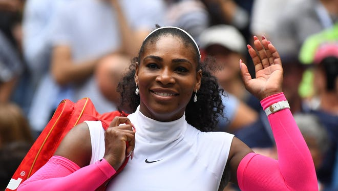 Serena Williams waves after beating  Johanna Larsson of Sweden during the 2016 U.S. Open.