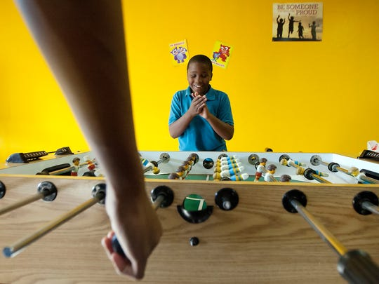 Demetrius Battle, 11, celebrates a foosball victory recently at The Bridge Youth Center in Fort Myers.