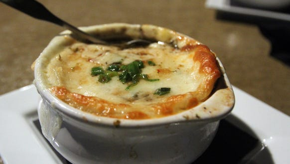 A bowl of French onion soup is pictured at Acme Burger