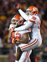 Clemson defensive linemen Christian Wilkins (42) and Clelin Ferrell (99) celebrate after Wilkins sacked Boston College quarterback Patrick Towles (8) during the 2nd quarter at Boston College's Alumni Stadium in Chestnut Hill, Mass. on Friday.
