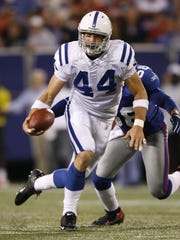Dallas Clark, of the Colts, tries to get extra yards on Antonio Pierce of the Giants during first quarter action.  Giants Stadium, New Jersey, September 10, 2006.  (Robert Scheer/The Indianapolis Star)