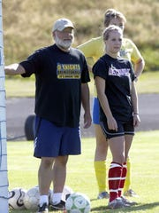 Lance McCoy is shown in 2008 in a previous stint as the Bremerton High girls soccer coach, next to his daughter Hannah.