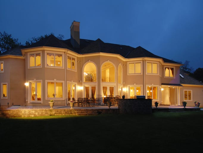 The mansion at 1A Maple Leaf Drive, Holmdel, sits on 1.2 acres of private property.