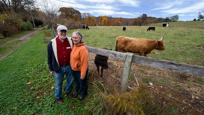 Mike Martin, left, and his wife, Debra, are shown at their organic farm,  Martin's Twin Brook Farm in Hellam Township. In the latest One Book, One Community effort, readers chose a book that focused on organic farming and sustainable food production.