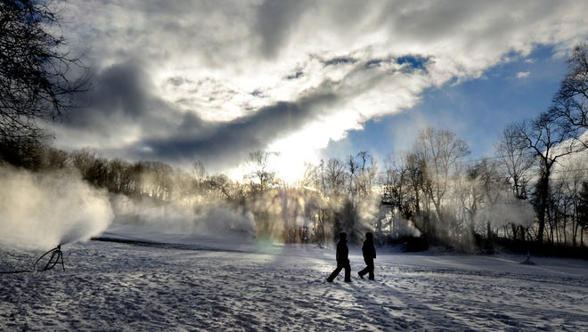 Snow crew members Jeff Predmore and Jonathan Sprenkle make their way to the next snow cannon on Fife & Drum at Roundtop Mountain Resort  Monday, Jan. 4, 2015. (John A. Pavoncello - The York Dispatch)