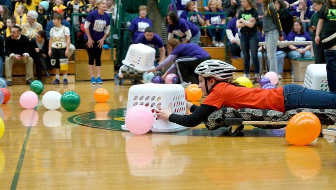 Lauren Shuleski, of York Catholic, plays a game of Hungry Hungry Hippo at the Catholic schools Battle of the Buildings.