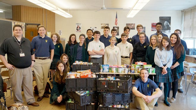 York Catholic High School teacher Andrew Downing is shown here with his class.