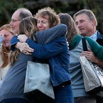 Faculty members embrace as they are allowed to return to Umpqua Community College Monday, Oct. 5, 2015, in Roseburg, Ore. The campus reopened to faculty for the first time since Oct. 1, when armed suspect Chris Harper-Mercer killed multiple people and wounded several others before taking his own life at Snyder Hall.