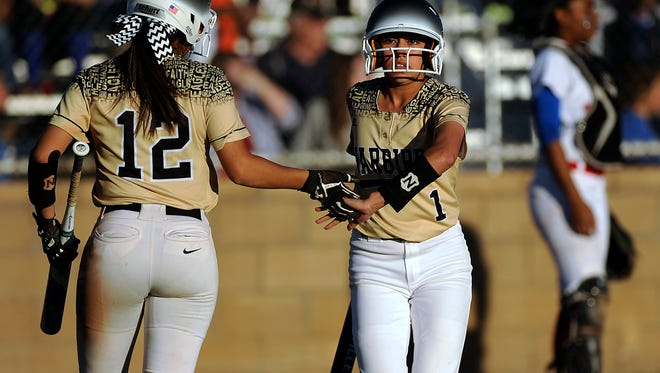 Abilene High's Mercedes Torres (1) is congratulated by teammate Aubrianna Salazar (12) after Torres scored in the top of the fourth inning of the Lady Eagles' 13-1 win in the Abilene Icebreaker softball tournament on Friday, Feb. 24, 2017, at Cooper High School.
