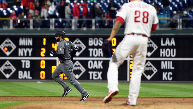 Arizona Diamondbacks' Alex Avila, rear, rounds the bases after hitting a solo home run off Philadelphia Phillies starting pitcher Vince Velasquez (28) during the third inning of a baseball game, Tuesday, April 24, 2018, in Philadelphia.