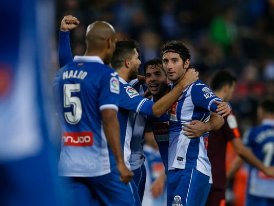 Espanyol's players celebrate during the Spanish Copa del Rey, quarter final, first leg, soccer match between Espanyol and FC Barcelona at RCDE stadium in Cornella Llobregat, Spain, Wednesday, Jan. 17, 2018. (AP Photo/Manu Fernandez)