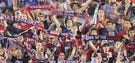 Fans hold up Indy Eleven banners. The Indy Eleven hosted Edmonton in a NASL soccer match at Michael A. Carroll Stadium Saturday May 10, 2014.