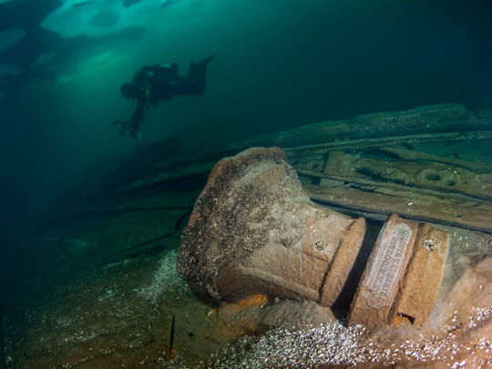"Diver Rich Synowiec explores near the capstan of ""Jana's Wreck"" in Lake Erie near Colchester, Ontario, Canada."