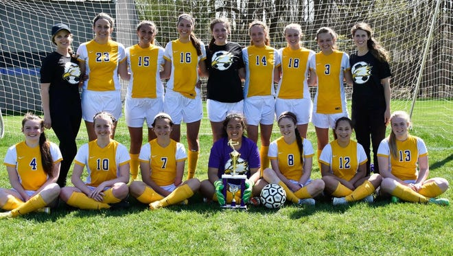"""Plymouth Christian Academy's varsity girls soccer team won the Jackson Royal Cup Saturday. The Eagles, coached by Annette Somercik, defeated Calhoun Christian 4-2 and then came back to defeat Lenawee Christian 2-0 in the championship goal with both goals by freshman Danae Moriarty. Helping preserve the win with an outsanding save on a penalty kick was Izzy Nunez. """"The girls are really united and it's fun to see how much they are pushing for each other,"""" Somercik said."""