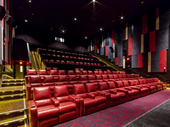 Plush red recliners fill AMC North Point Mall 12 in