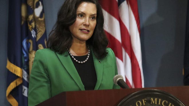 Mich. Gov. Gretchen Whitmer speaks during a coronavirus briefing in Lansing on Friday, Aug. 14. Whitmer announced a state partnership with Ford Motor Company and FEMA to distribute 4 million facemasks to vulnerable Michigan residents.