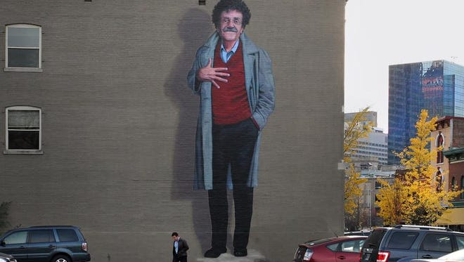 This larger-than-life mural (38 feet tall) of Kurt Vonnegut, on the east side of a building in the 300 block of Massachusetts Avenue in Downtown Indianapolis, is by artist Pamela Bliss.